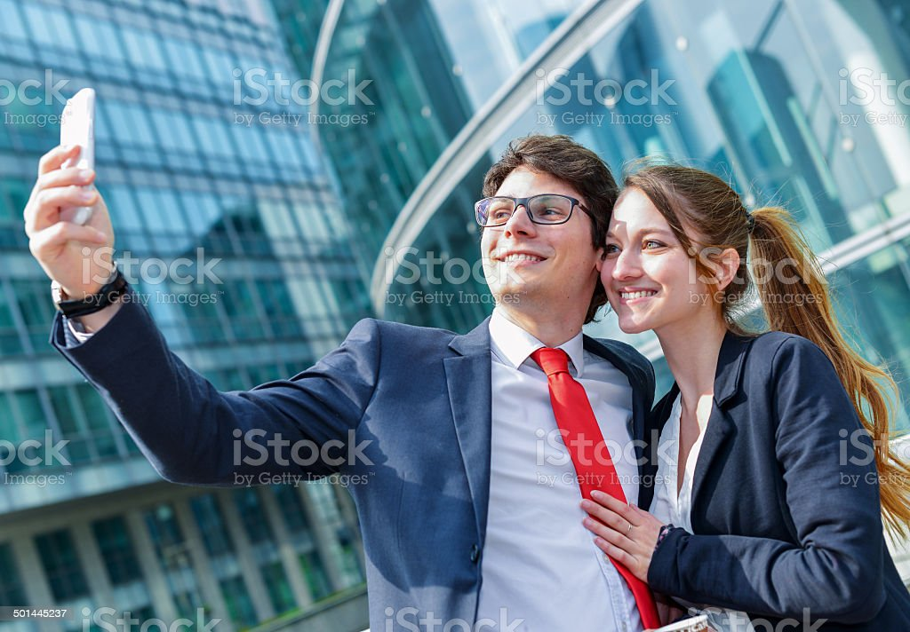 Young working colleagues photographing themselves royalty-free stock photo