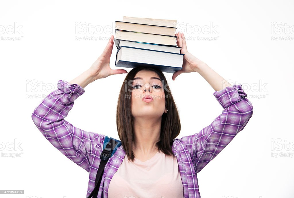 Young wowan holding books on head stock photo