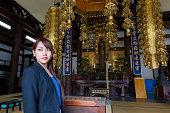 Young wowan standing inside temple