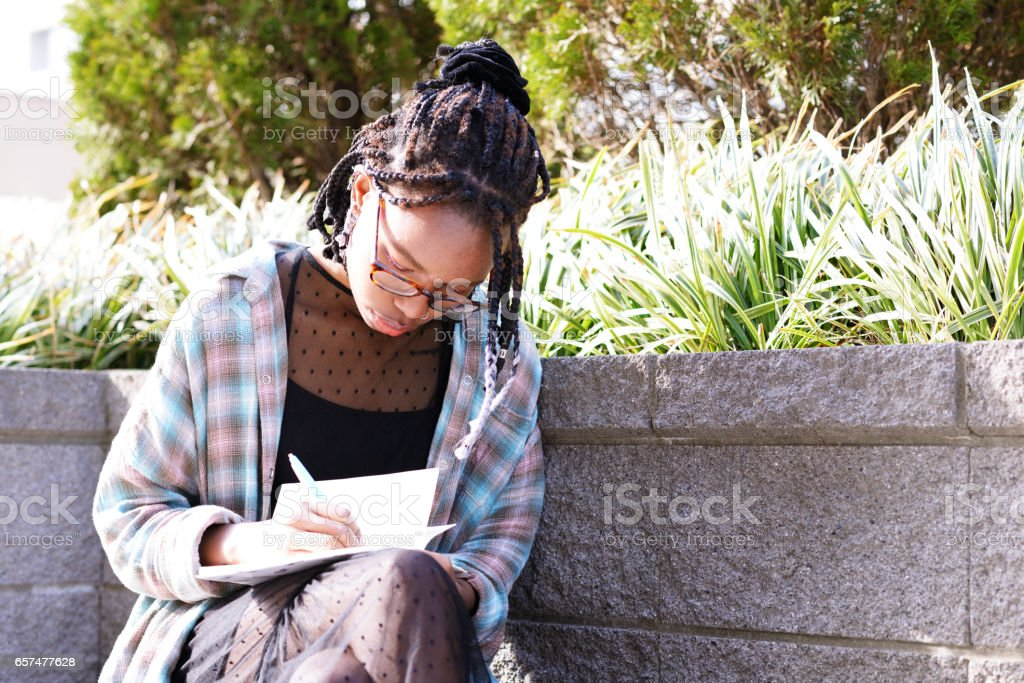 Young writer at work stock photo