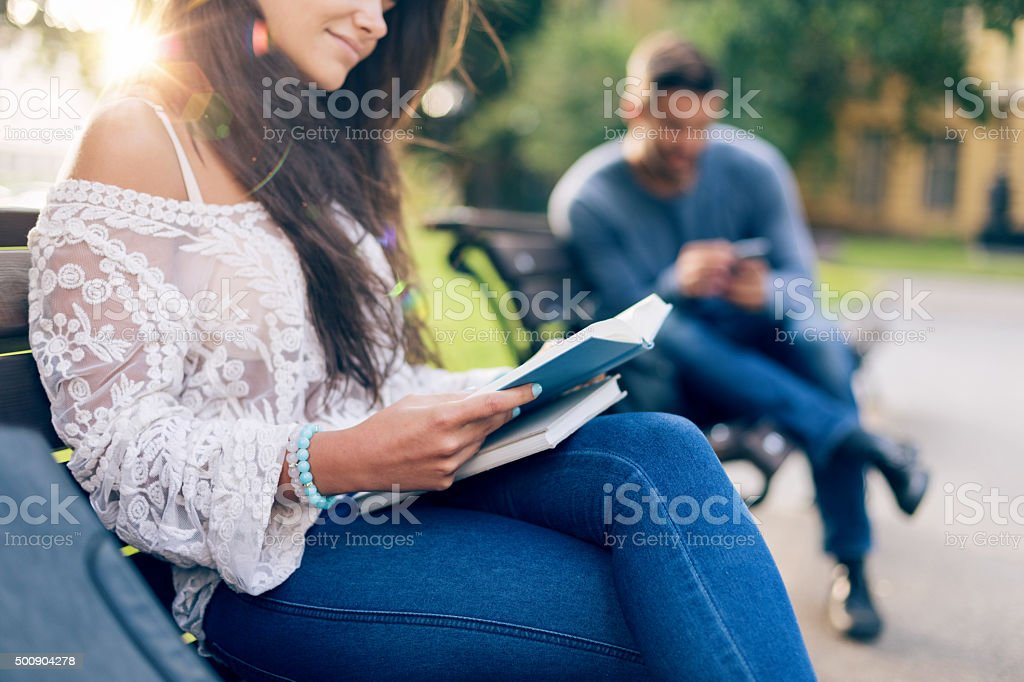 Younge couple wasting time in the city park stock photo
