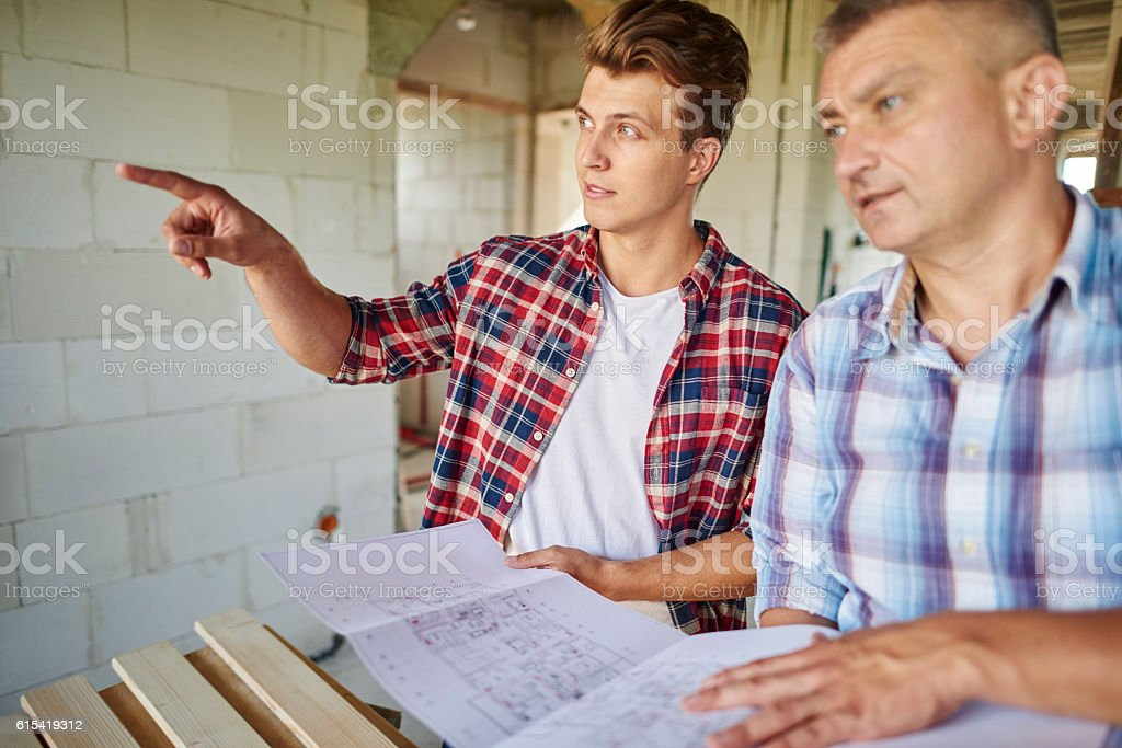 Younger carpenter has got an idea and vision stock photo