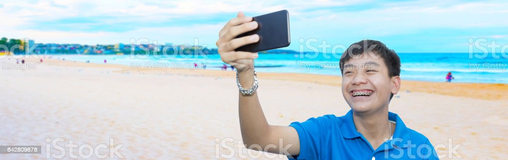 Youngman smile and selfie for holiday or summer background. stock photo