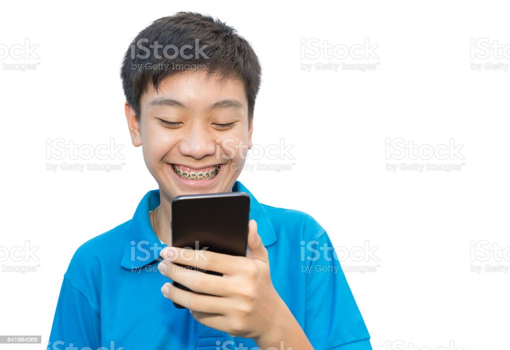 Youngman smiling teeth brace dental using smartphone on isolated background stock photo