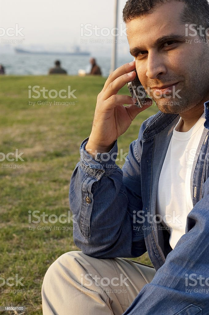 youngman working in meadow stock photo