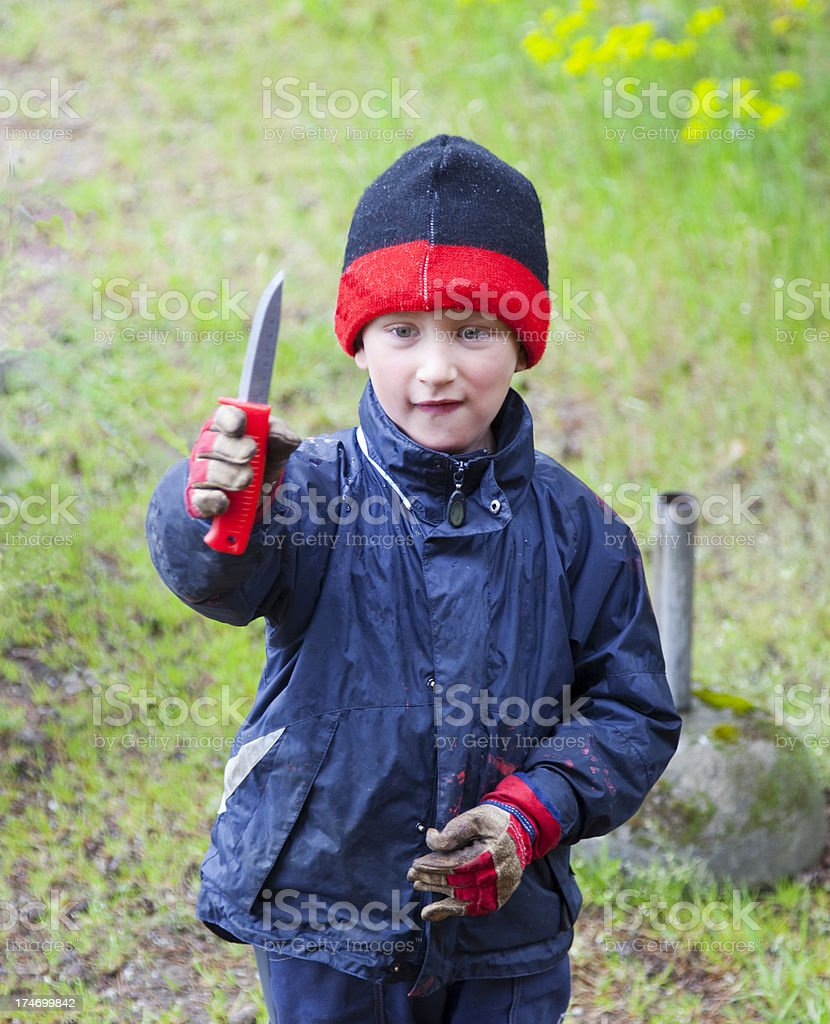 Youngster with a knife. stock photo