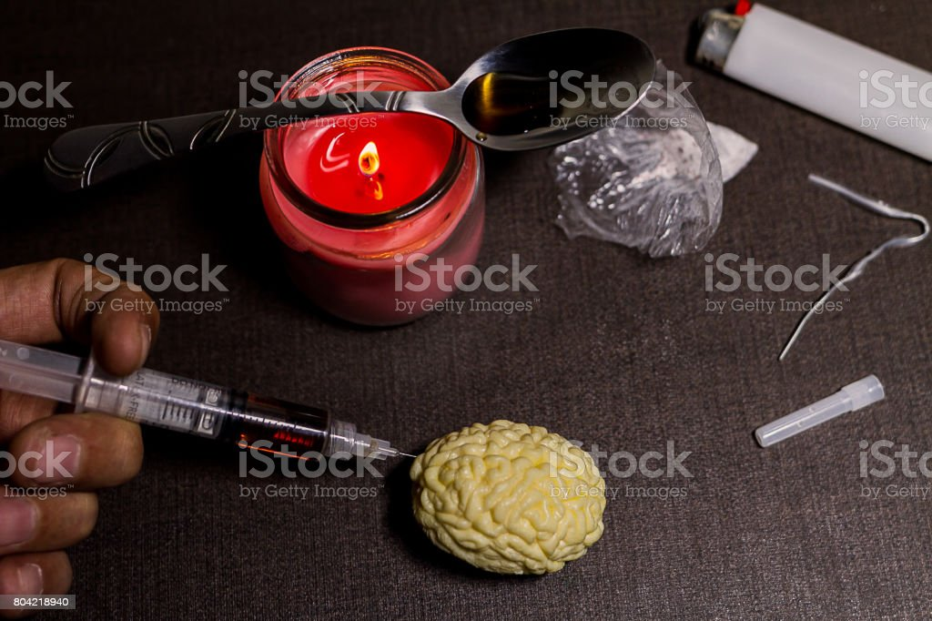 Your Brain on Drugs (Heroine Use and Abuse) Addiction and the issues it causes for individuals and Society stock photo