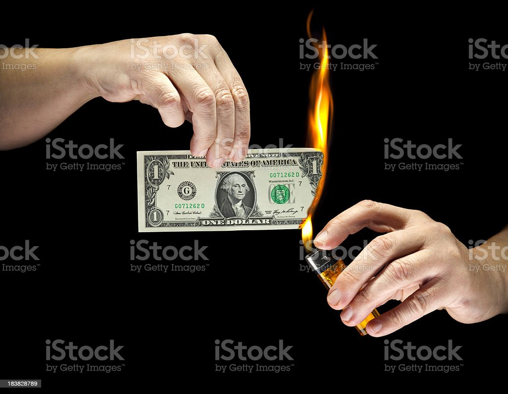 Your Money Going Up in Flames stock photo