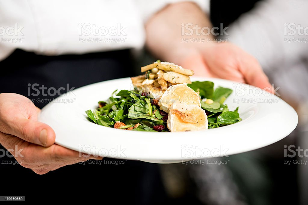 Your salad is ready sir. stock photo