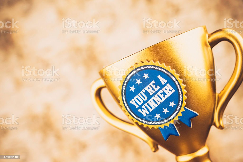 You're a winner! Gold trophy with congratulatory message. Success. stock photo