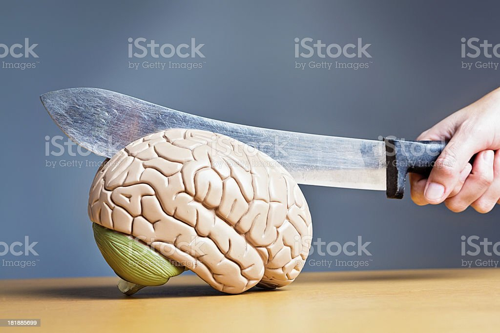 You're doing my head in! Hand slicing into brain royalty-free stock photo
