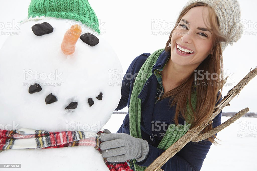 You're never too old to build a snowman royalty-free stock photo