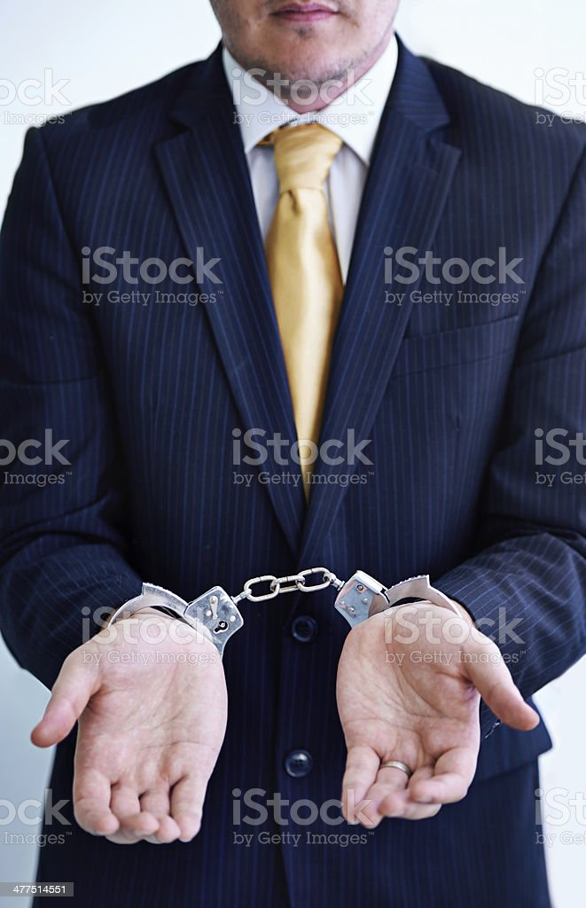 You're under arrest for committing fraud royalty-free stock photo