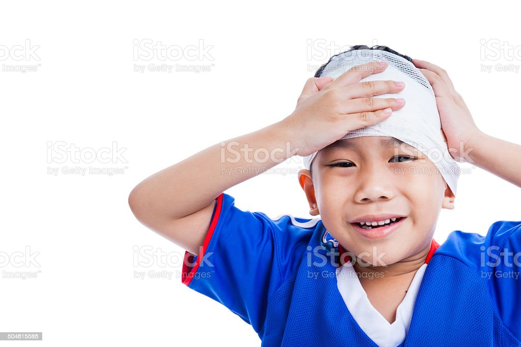 Youth athlete asian child with trauma of the head crying. stock photo
