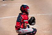 Youth baseball catcher behind home plate.