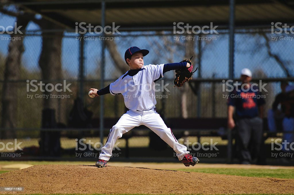 Youth baseball pitcher in wind up stock photo