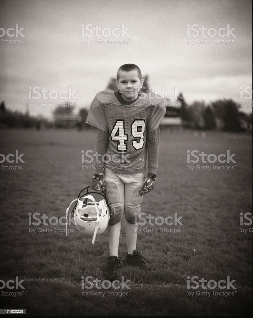 Youth Football Player After the Game stock photo