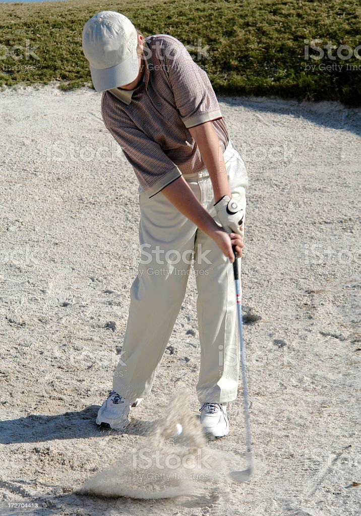 Youth Hitting Out Of Sand Trap royalty-free stock photo