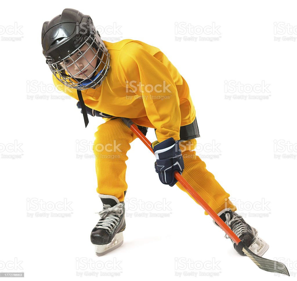 Youth hockey player in crouch position royalty-free stock photo