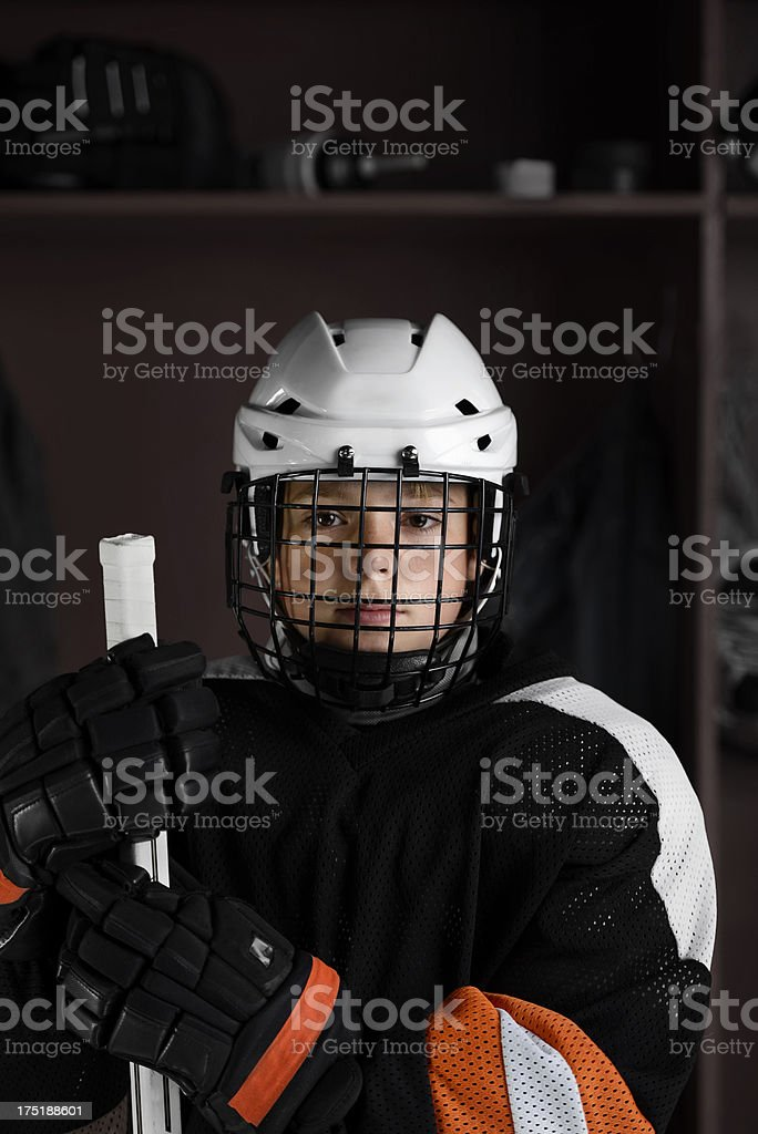 Youth Hockey player in dressing room royalty-free stock photo