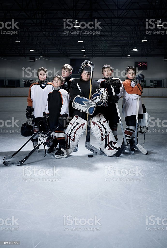 A youth hockey team on the ice in an arena with lot\'s of copy space.