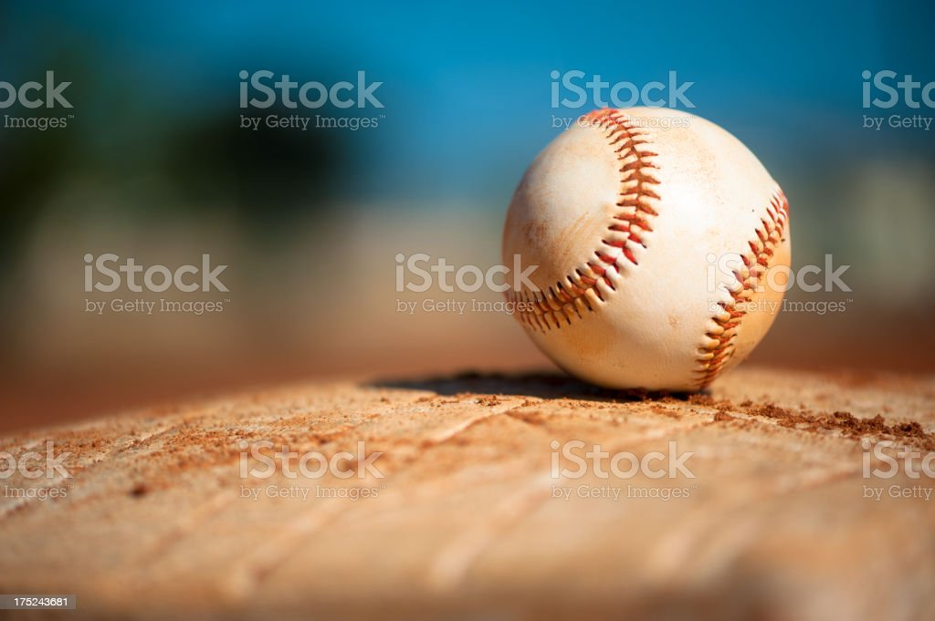 Youth League Baseball on First Base Close Up stock photo