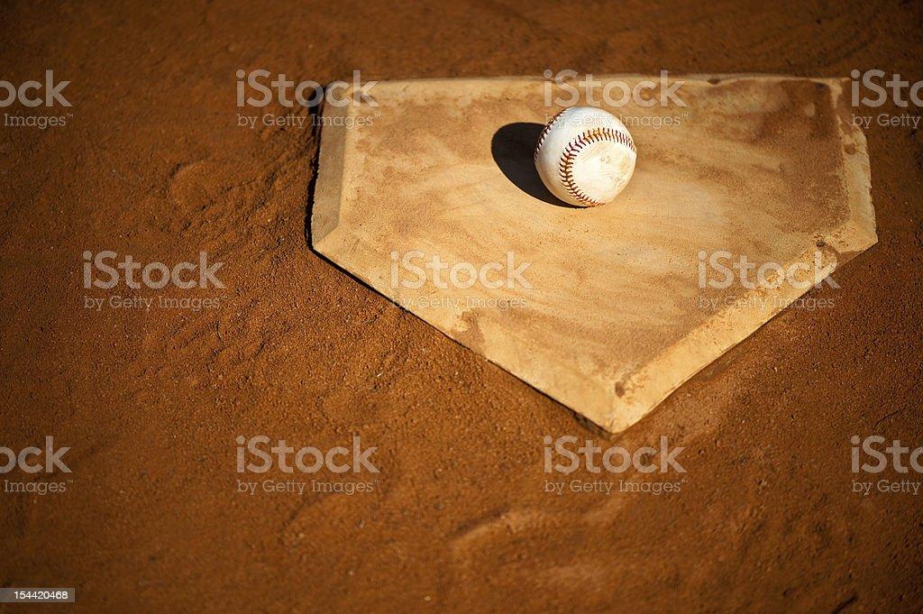Youth League Baseball on Home Base Close Up royalty-free stock photo
