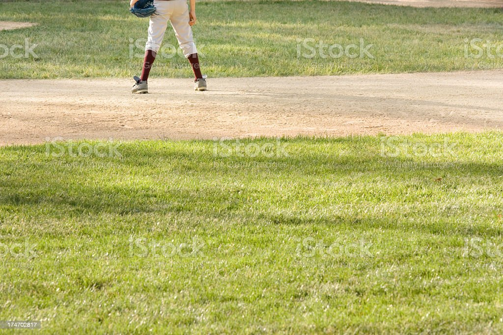 Youth league baseball player waiting for a hit royalty-free stock photo