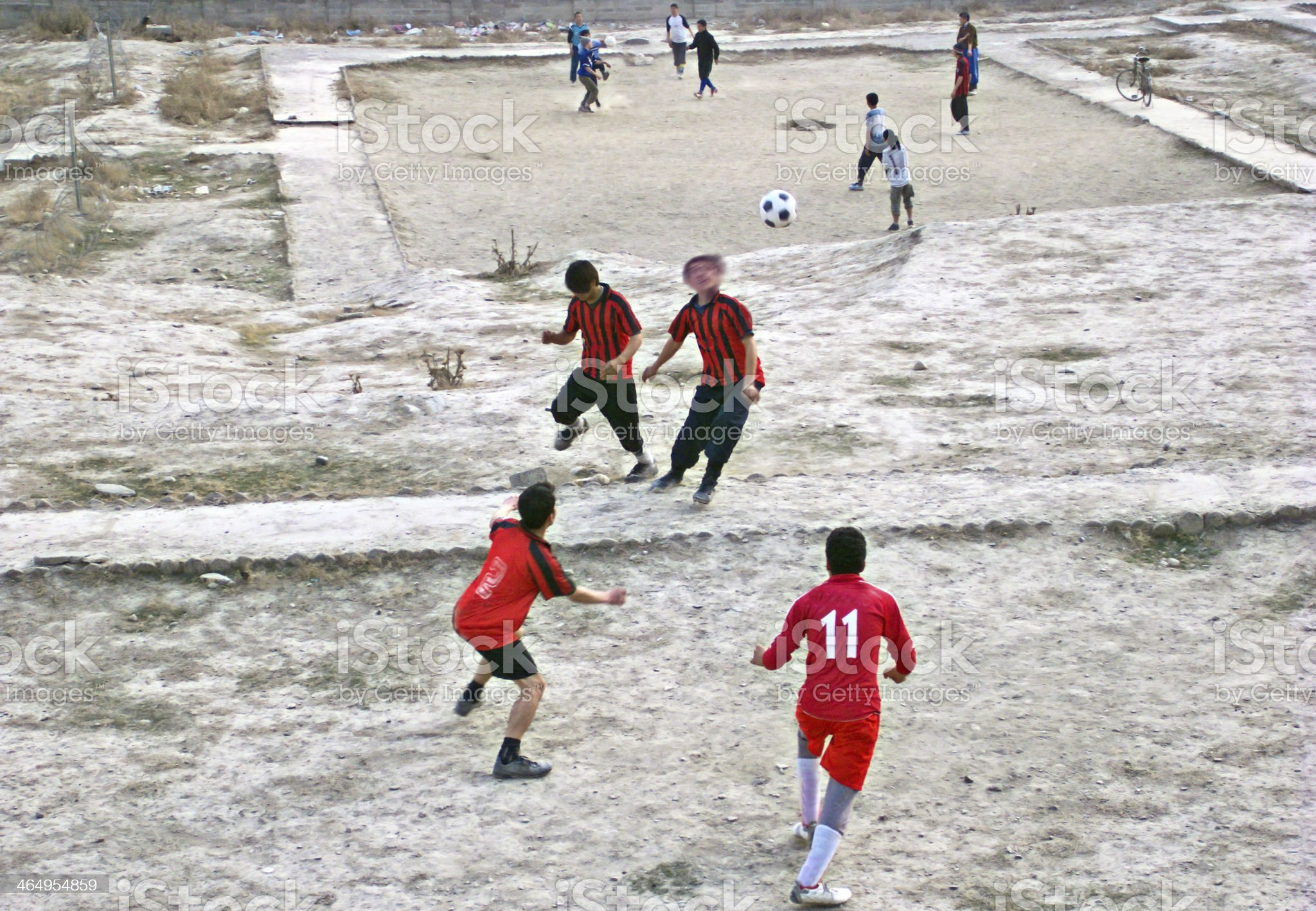 Youth playing backyard football in Kabul, Afghanistan royalty-free stock photo