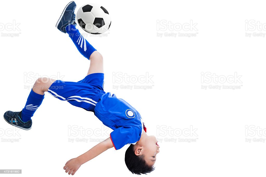 Youth soccer player kicking the ball stock photo