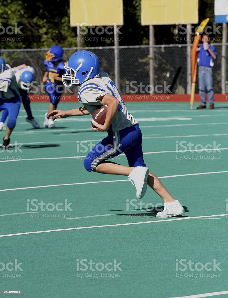 Youth Teen Football Player Running With Ball 2 stock photo