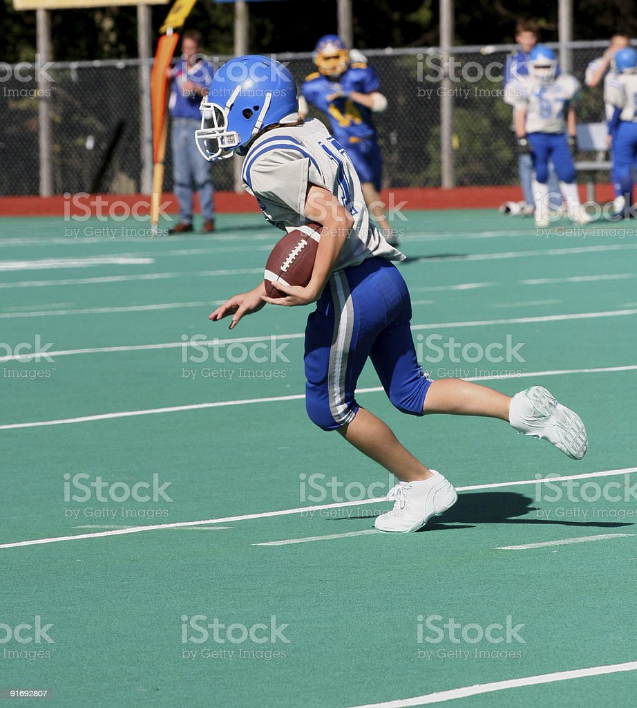 Youth Teen Football Player Running With Ball stock photo