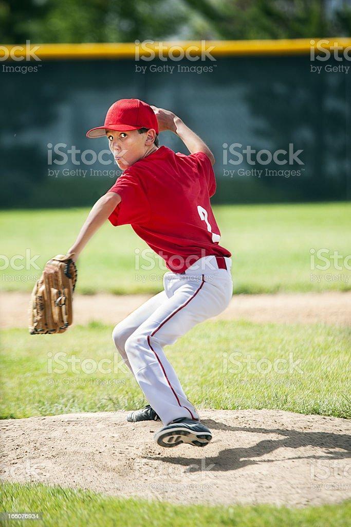 Youthful Male Baseball Pitcher Eyes Camera Winding Up on Moung stock photo
