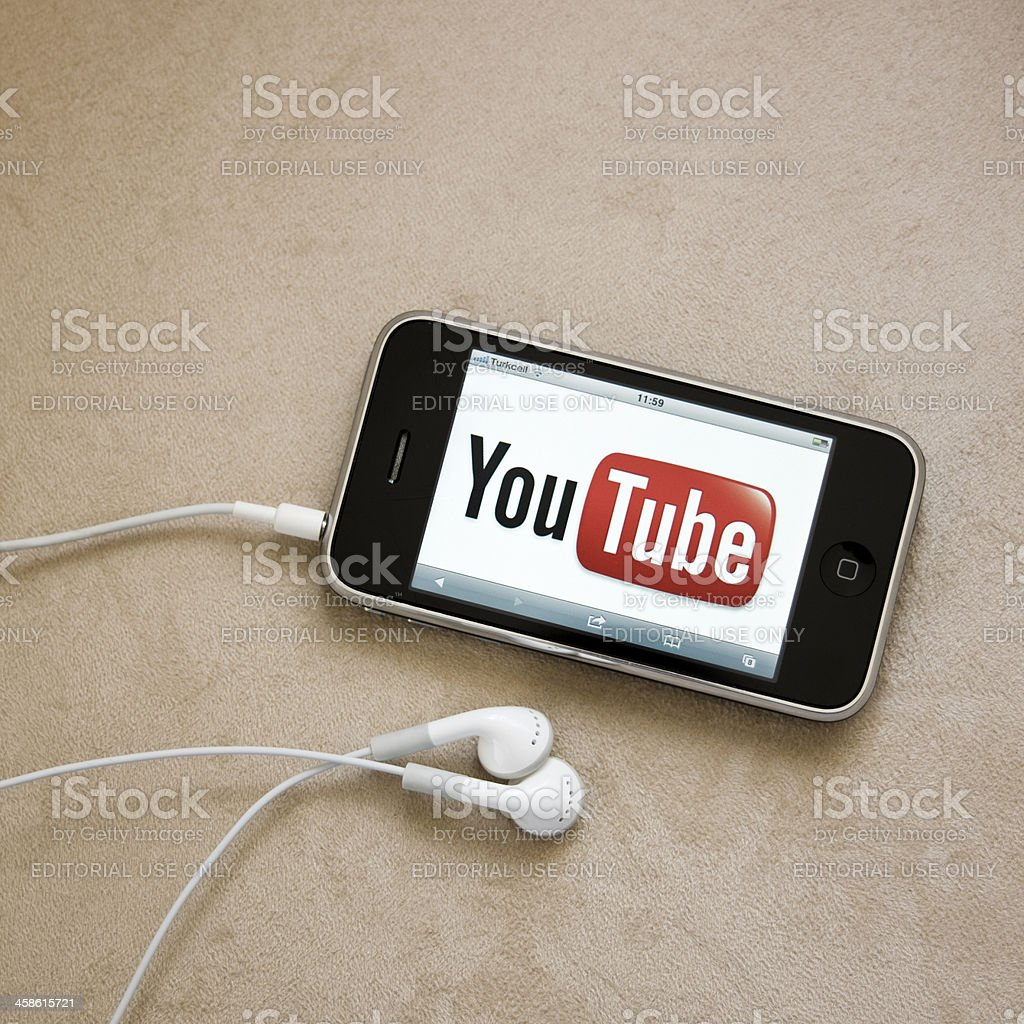 Youtube logo on iPhone screen stock photo