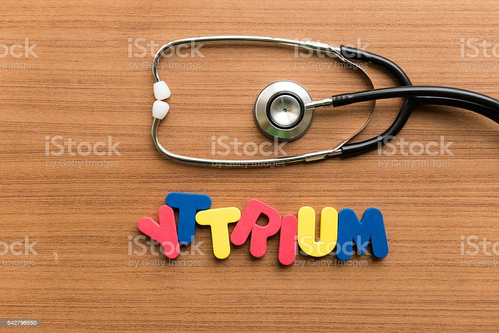 yttrium colorful word with stethoscope stock photo