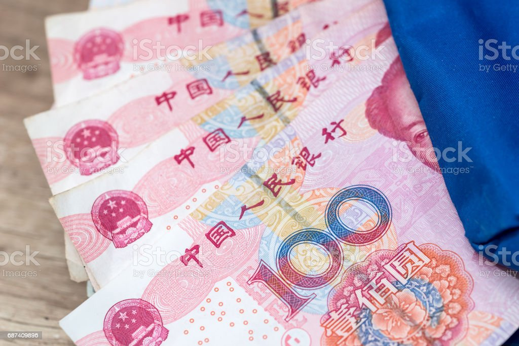 yuan banknote in blue wallet on desk. stock photo