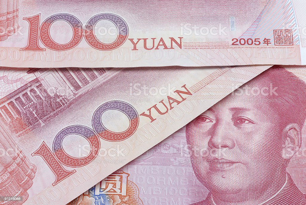 Yuan notes or bills overlaid royalty-free stock photo