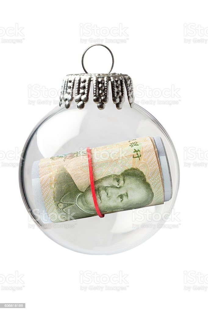 Yuan Rolled Up in a Christmas Ornament stock photo