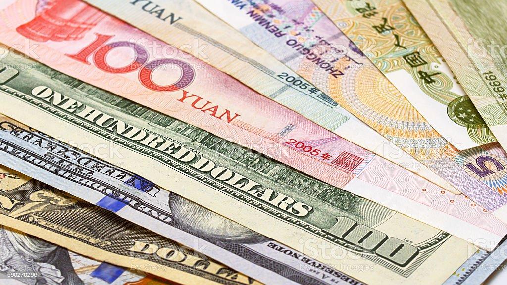 Yuan vs Dollar bank notes concept stock photo