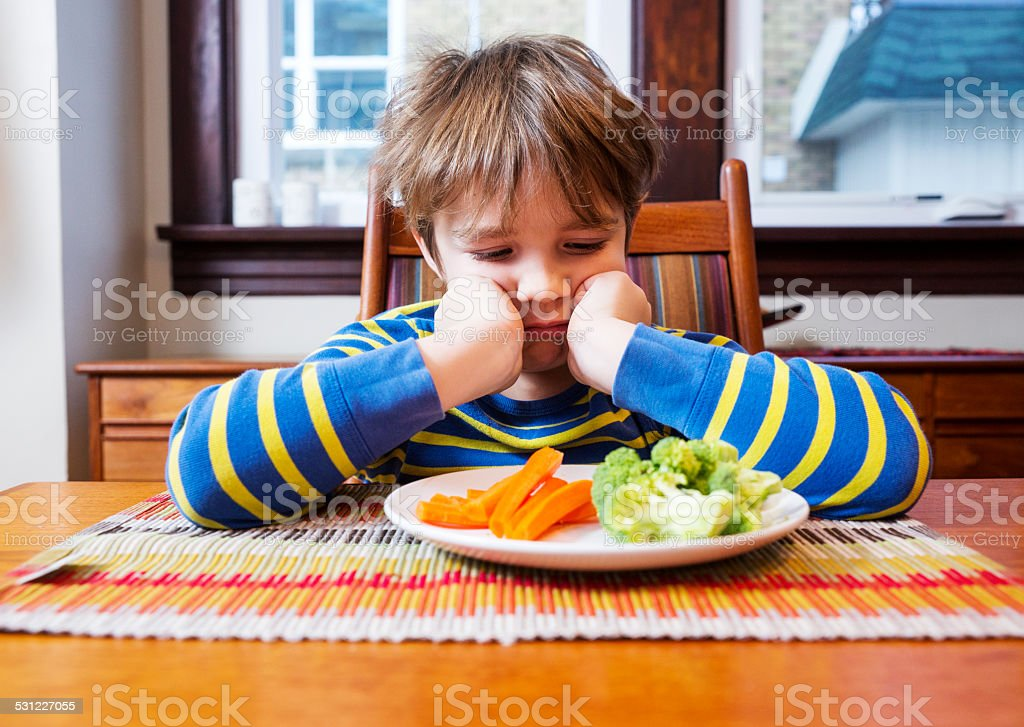 Yuck, I really hate vegetables stock photo