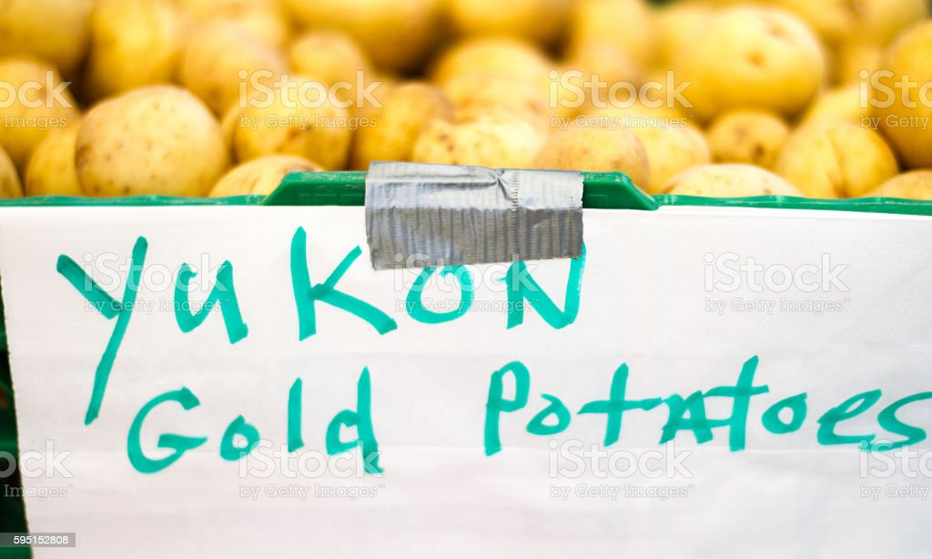Yukon Gold Potatoes PIled Up at Farmer's Market (Close-Up), Label stock photo