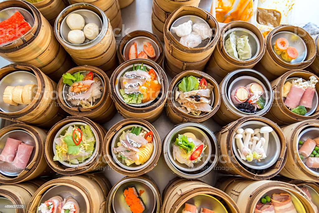 yumcha, dim sum in bamboo steamer, chinese cuisine stock photo