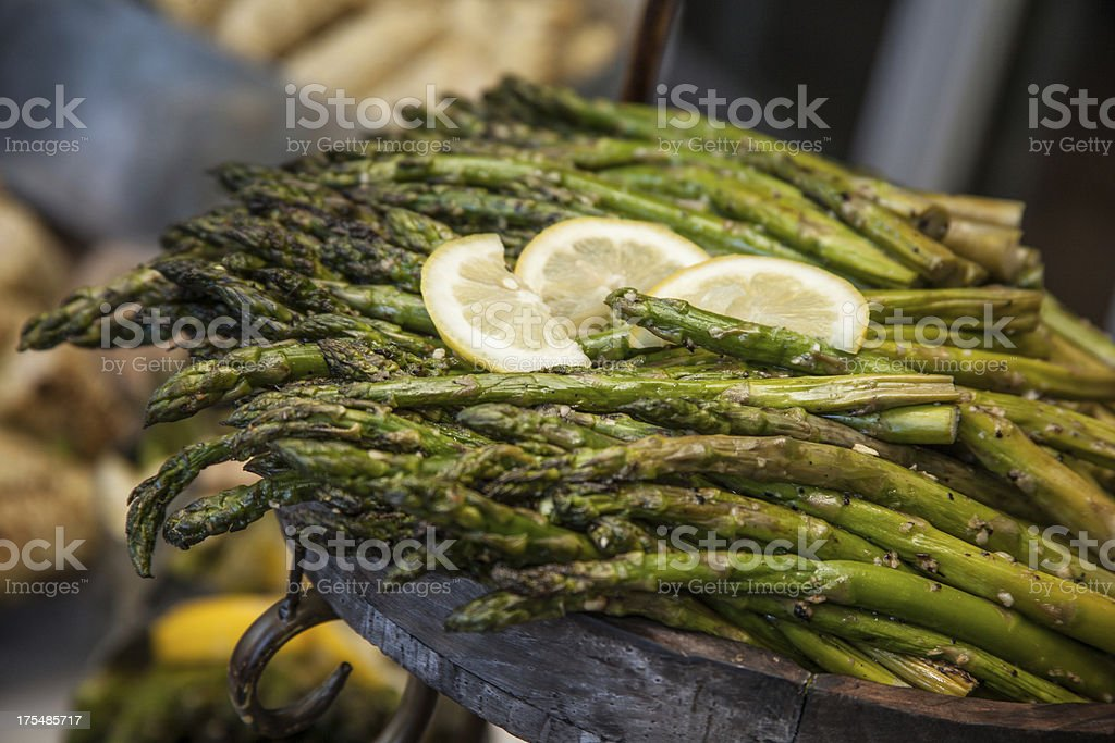 Yummy Asparagus for Dinner with Lemon Slices and Seasoning Flavor stock photo