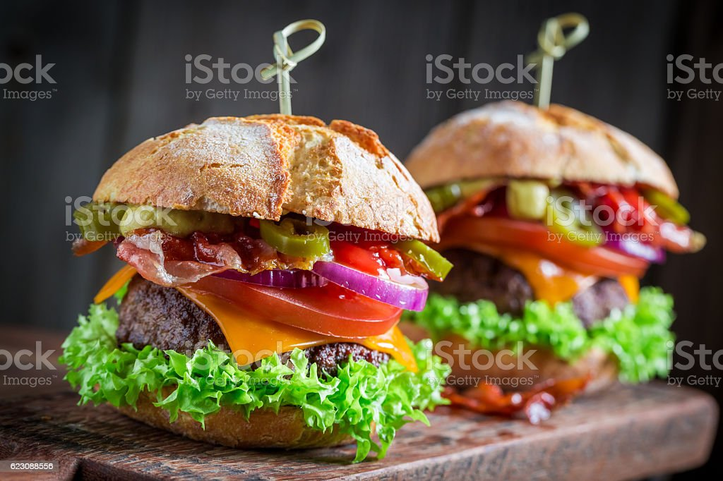 Yummy hamburger made of onion, tomato and lettuce for two stock photo