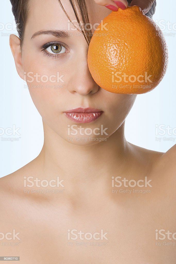 yung beauty girl hold orange in front of eye royalty-free stock photo