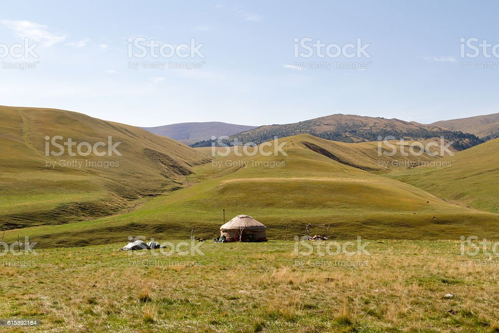 yurt in a pasture in the mountains stock photo