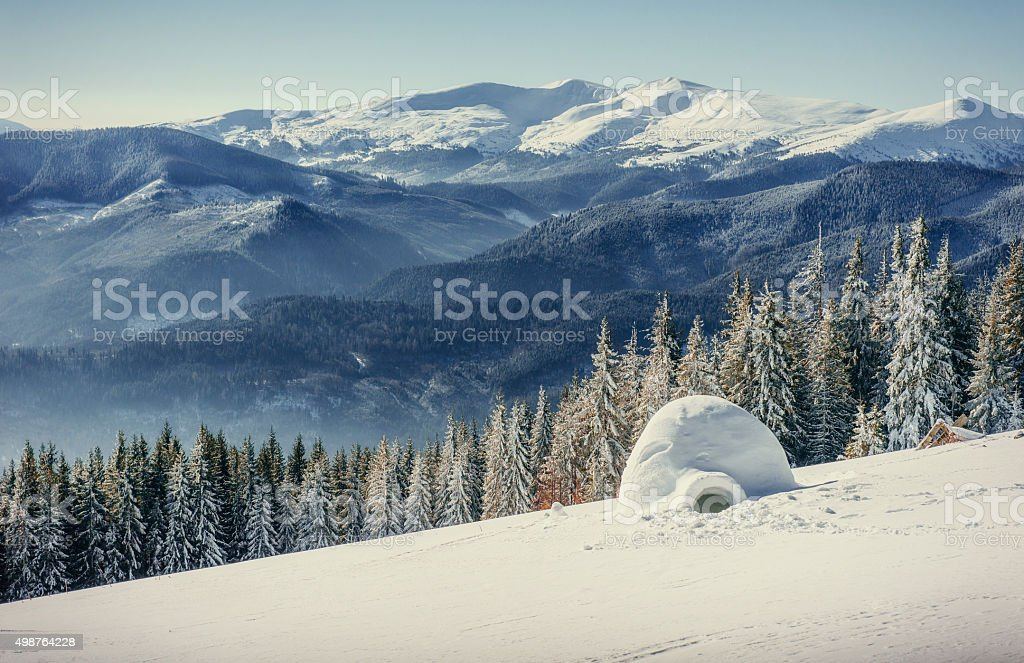 yurt  in winter fog mountains. Carpathian, Ukraine, Europe. stock photo