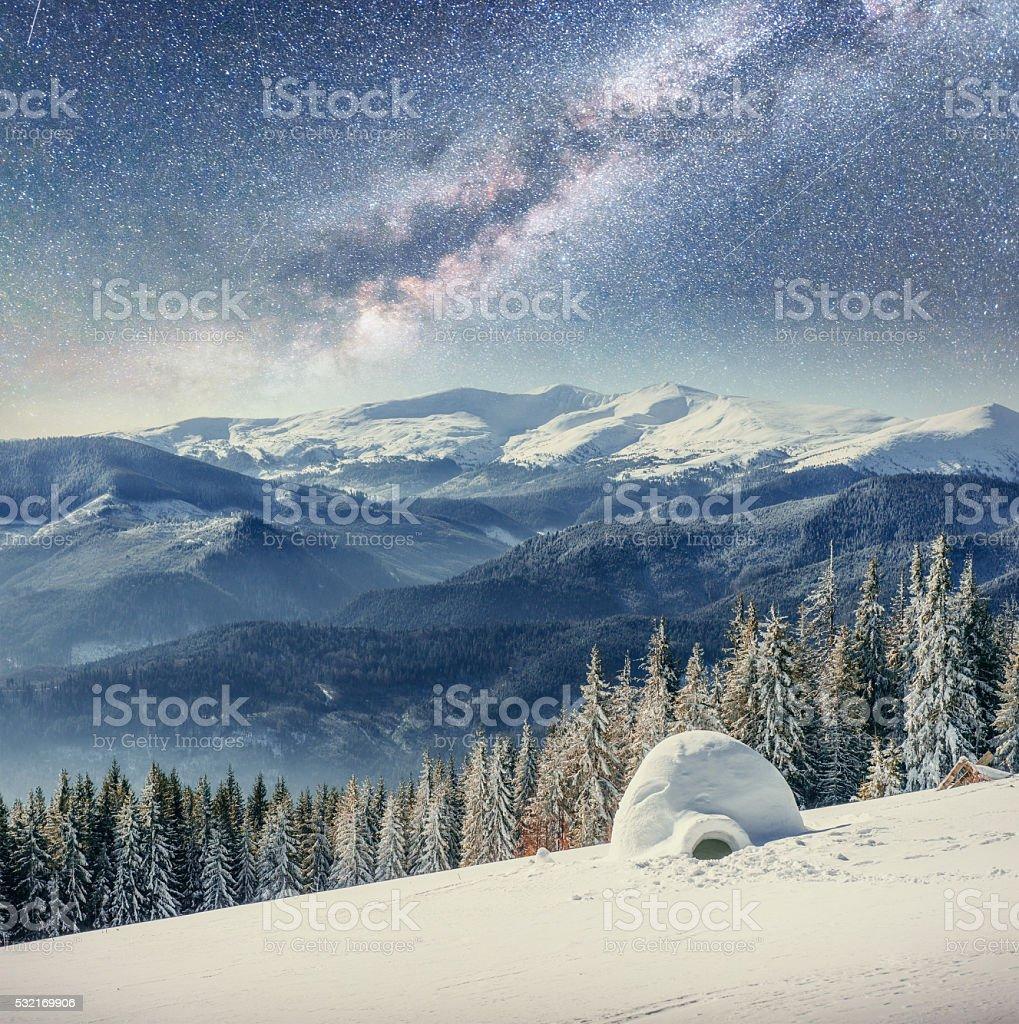 yurt in winter mist mountains under the stars. Carpathian, stock photo