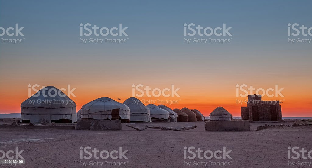 Yurts at sunset in the desert stock photo