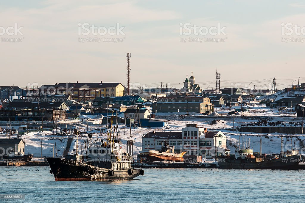 Yuzhno-Kurilsk with standing in the boat harbor stock photo